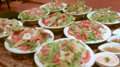 Many salads on table at restaurant pull focus. Stock Footage