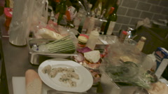 Messy commercial kitchen ingredients and food preparation. - stock footage