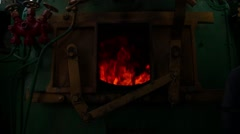 Steam train's furnace opens and closes. Stock Footage