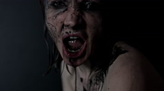 4k shoot of a horror Halloween model spitting black water from mouth Stock Footage