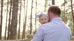 Father and daughter having fun in park, garden, man playing with girl outdoors Stock Footage