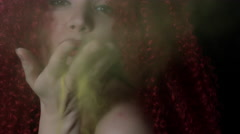 4k shoot of a redhead girl in studio blowing dust. Focus on face Stock Footage