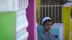 Malay Muslim boy portrait Stock Footage