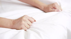 hands of a couple in bed. - stock footage