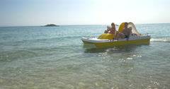 Family enjoying sea ride on pedal boat Stock Footage