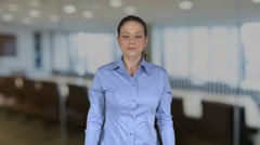 Female business person with flirtatious look in an office Stock Footage