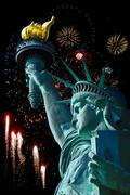 Statue of Liberty in New York City  and fireworks. Stock Photos