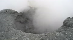Volcanic activity - boiling thermal mud pot in crater of active volcano Stock Footage