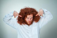 The young vexed man - stock photo