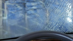 The interior of car as it is cleaned in a car wash Stock Footage