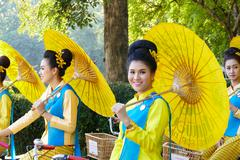 Chiang Mai, Thailand -  December 11, 2015: The girl in traditional dress hold Stock Photos