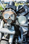 Detail of veteran motorbike with symbolic gas mask Stock Photos