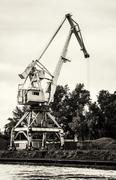 Crane in cargo port, black and white photo Stock Photos