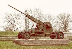 Anti-aircraft machine gun, war industry, yellow photo filter Stock Photos