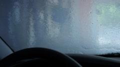 Water running down windsheild during car wash Stock Footage
