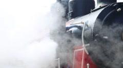 Restored steam locomotive steaming. Much of steam in frame. Stock Footage