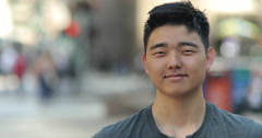 Young Asian man face close up portrait smile happy Stock Footage