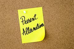Present Alternatives written on yellow paper note Stock Photos