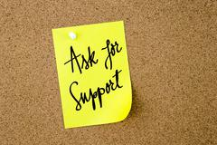 Ask For Support written on yellow paper note Stock Photos