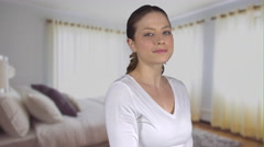 Healthy natural female stands in bedroom Stock Footage
