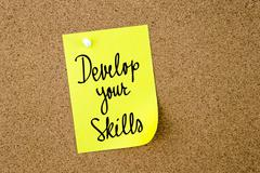 Develop Your Skills written on yellow paper note Stock Photos