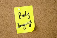 Body Language written on yellow paper note Stock Photos