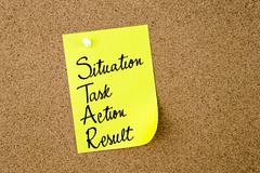 STAR as Situation, Task, Action, Result written on yellow paper note - stock photo