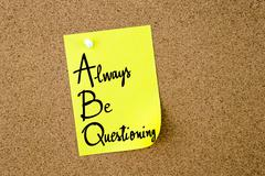 ABC Always Be Questioning written on yellow paper note Stock Photos