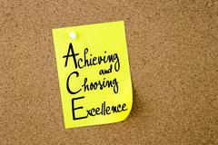 ACE Achieving and Choosing Excellence written on yellow paper note Stock Photos