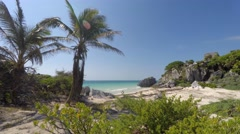Mayan ruin at Tulum on coastline near Cancun in jungle panning shot Stock Footage