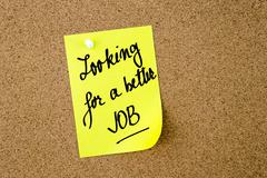 Looking For A Better Job written on yellow paper note - stock photo