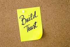 Build Trust written on yellow paper note - stock photo