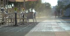 Man washing sidewalk in the morning Stock Footage