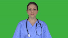Expressionless female medical professional (Green Key) Stock Footage