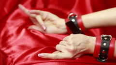female hands in leather handcuffs. sex toys. - stock footage