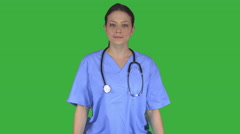 Cheerful smiling nurse doctor (Green Key) - stock footage