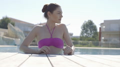 Young adult standing in swimming pool - stock footage