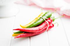 Different colors chilli peppers. Stock Photos