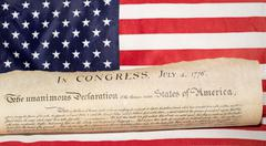 American Declaration of independence 4th july 1776 on usa flag background - stock photo