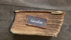 Education text and vintage book on table Stock Footage