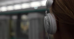 Girl listening to music in metro Stock Footage