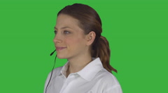 Female tech support handles call (Green Key) Stock Footage