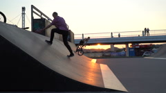 Skaters on the ramp before sunset Stock Footage