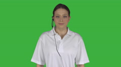 Female technical support crosses arms (Green Key) Stock Footage