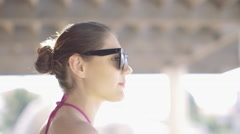 Young adult looking over sunglasses to camera - stock footage