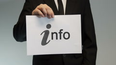 Businessman shows printed info sign. - stock footage