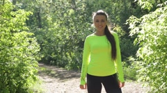 Active young sport woman video portrait. Looking at the camera and then run away Stock Footage