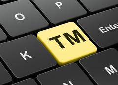 Law concept: Trademark on computer keyboard background Stock Illustration