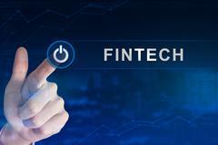 Business hand clicking fintech or financial technology button Stock Photos