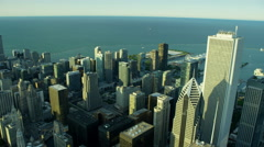 Aerial view of downtown Chicago city buildings and Navy Pier Stock Footage